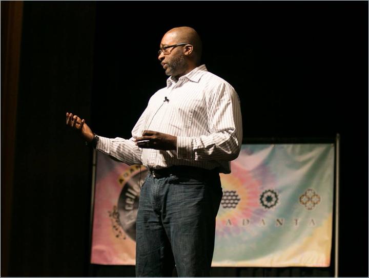 Hasan speaking on stage